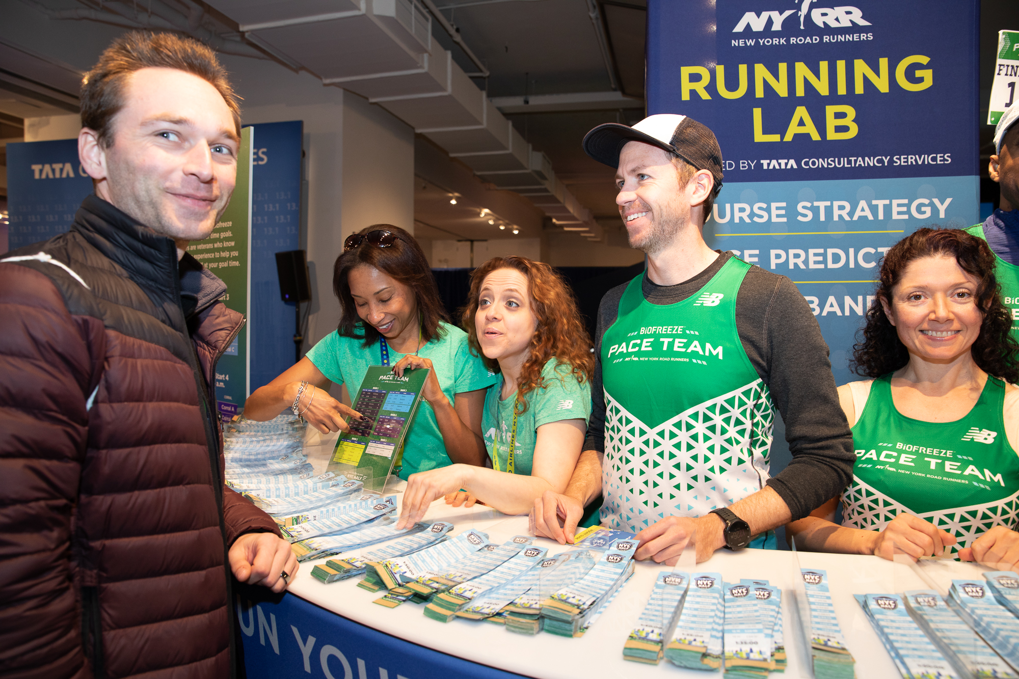 A runner picking up his race materials from the United Airlines NYC Half expo