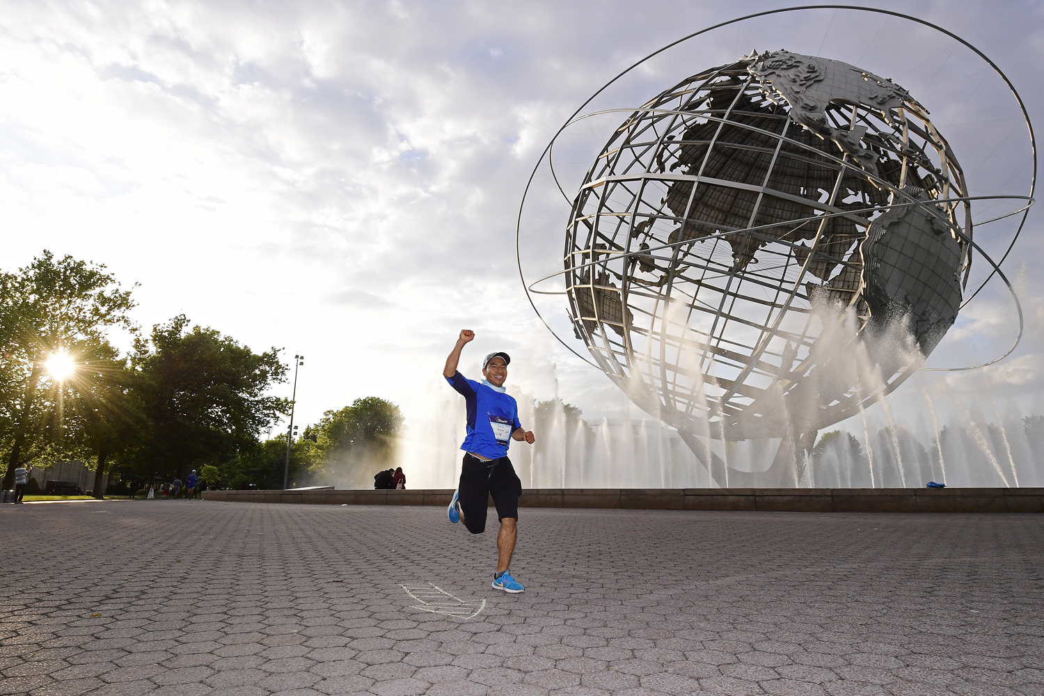 A runner in front of the globe at Flushing Meadows Corona Park in Queens
