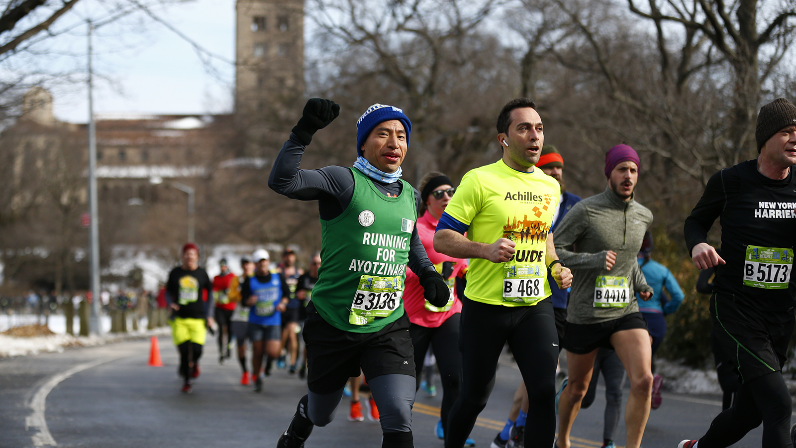 Club runners in a race in Central Park during winter