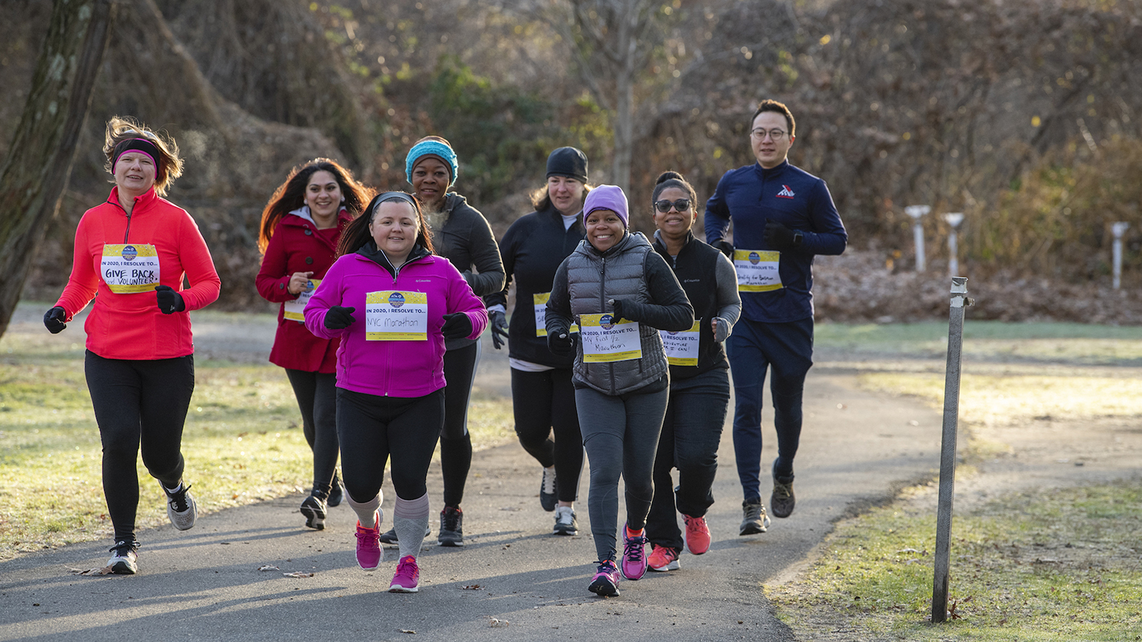 A group of runners in a park for an Open Run