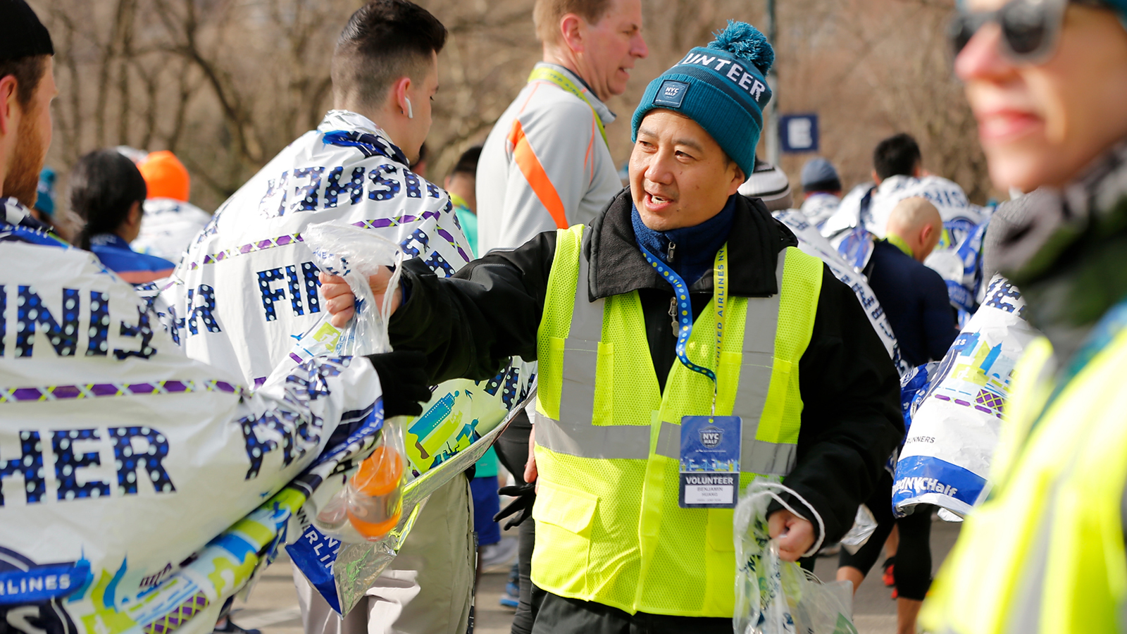 A volunteer handing out recovery bags at the finish of the United Airlines NYC Half