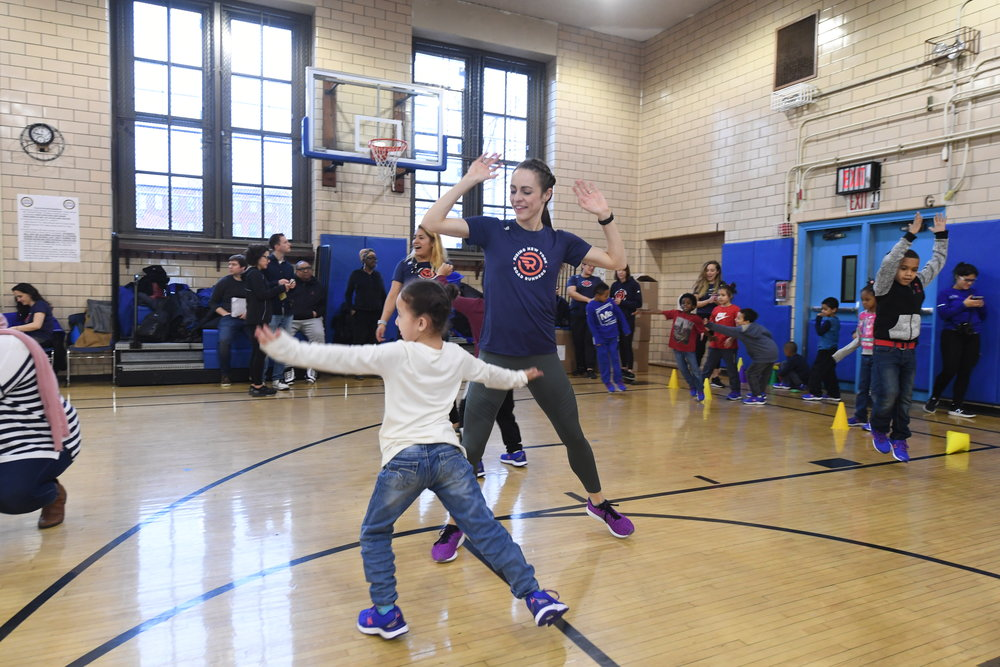 Kids got to play games with Olympian Jenny Simpson at the 1 for You 1 for Youth shoe distribution in Red Hook.