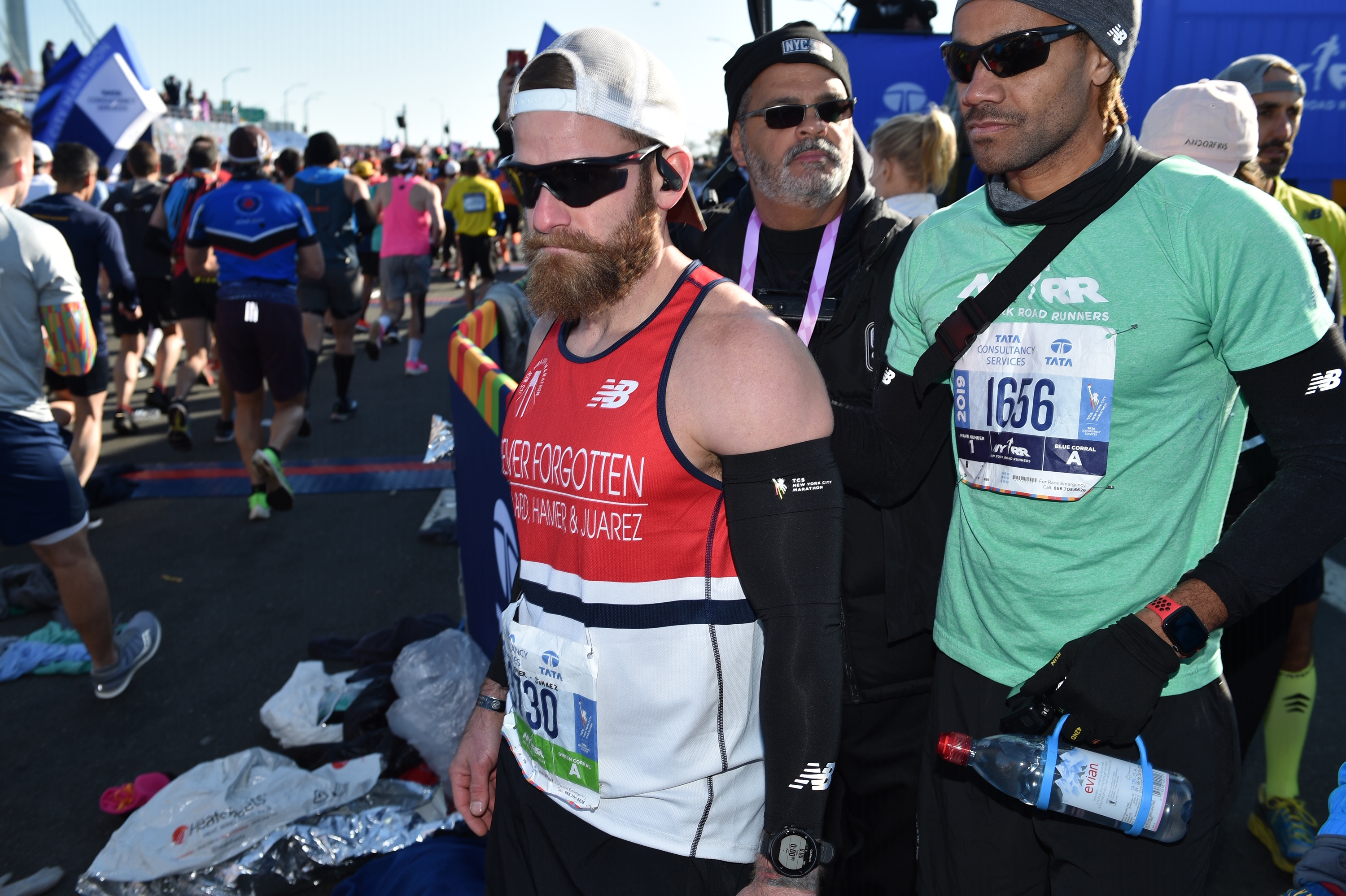 Micah Herndon, left, and his coach Roberto Mandje of NYRR, at the start of the TCS NYC Marathon.