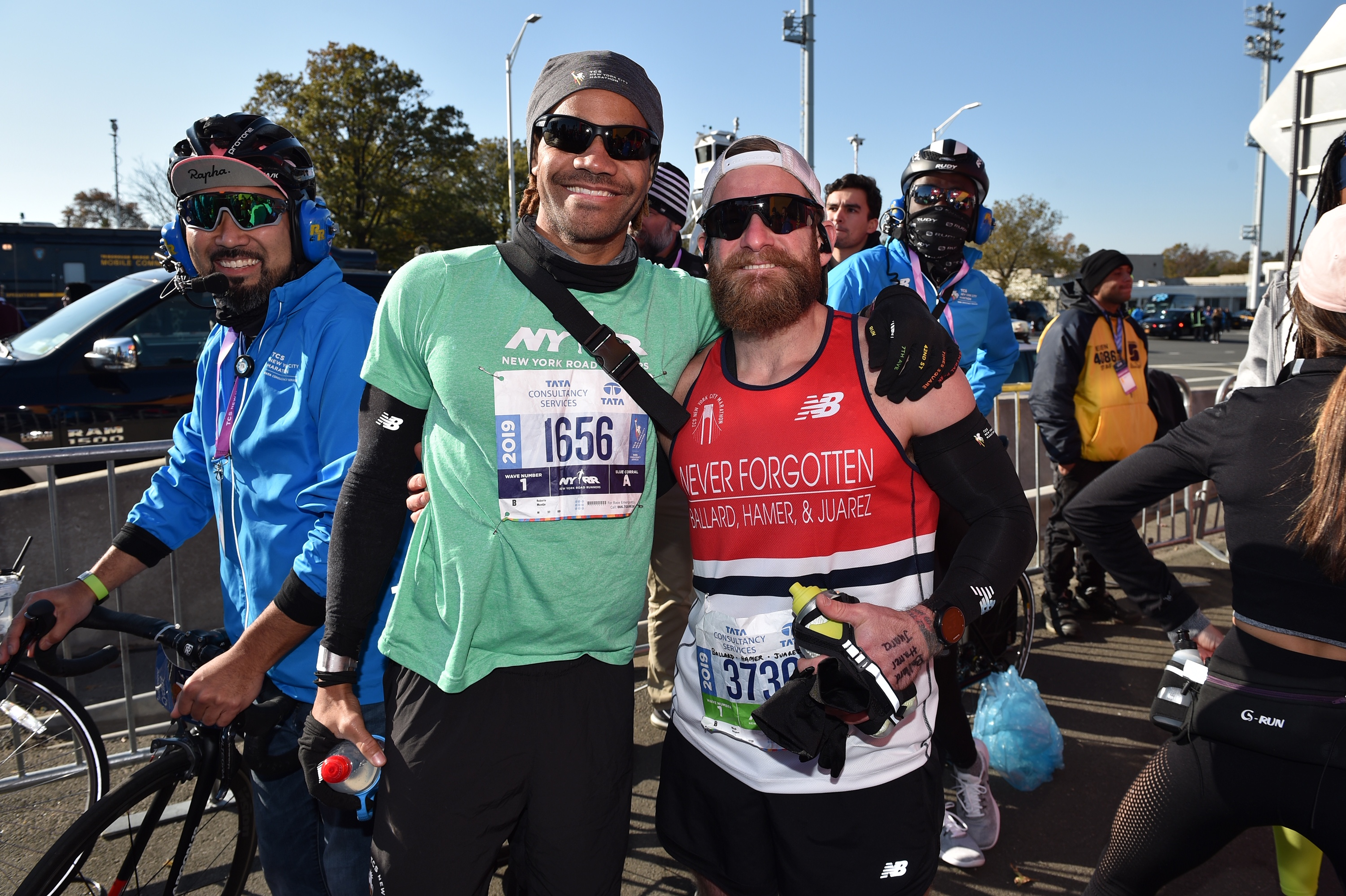 Micah Herndon, right, and his coach Roberto Mandje of NYRR, at the start of the TCS NYC Marathon.