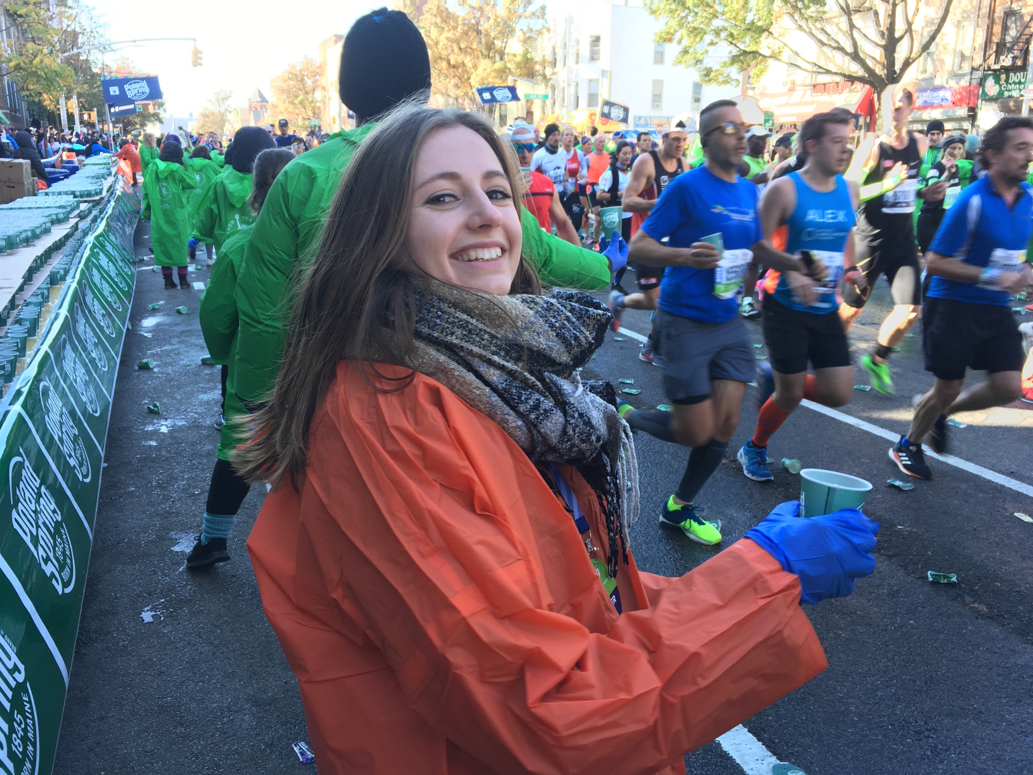 A volunteer with the Exchange Visitor Program hands out water during the TCS NYC Marathon.