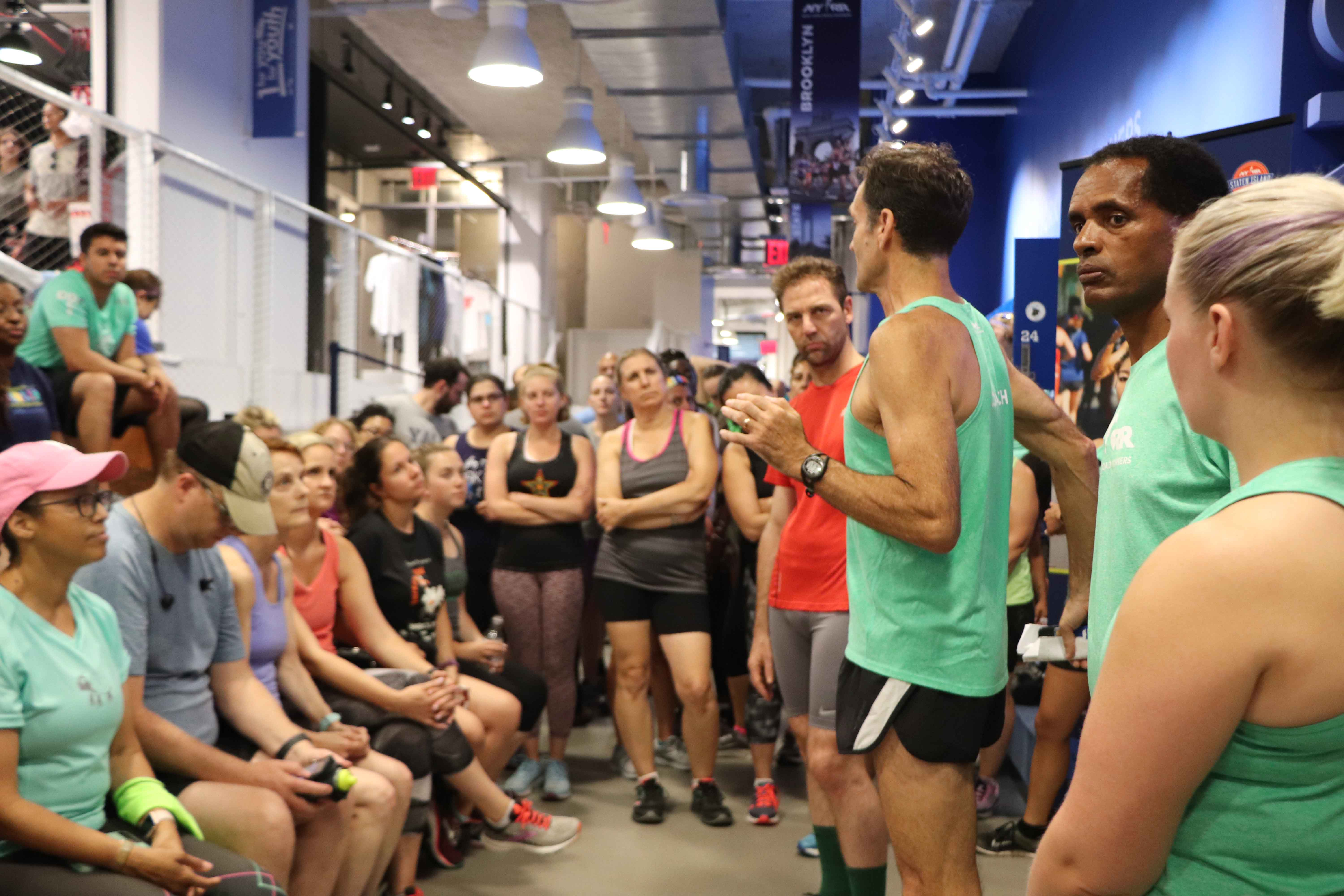 NYRR coaches speaking to runners at the NYRR RUNCENTER