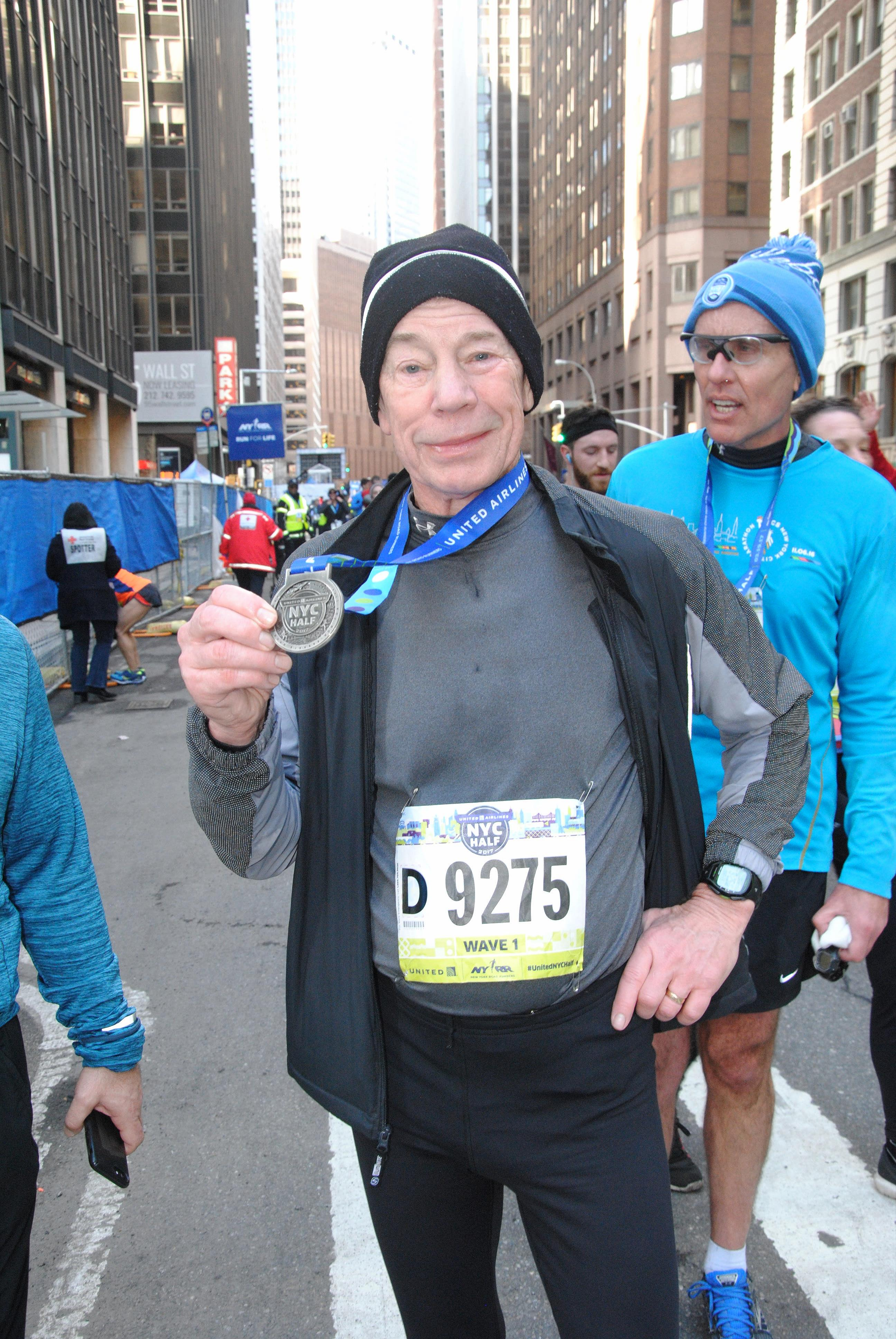 A runner with a finisher medal at the United Airlines NYC Half