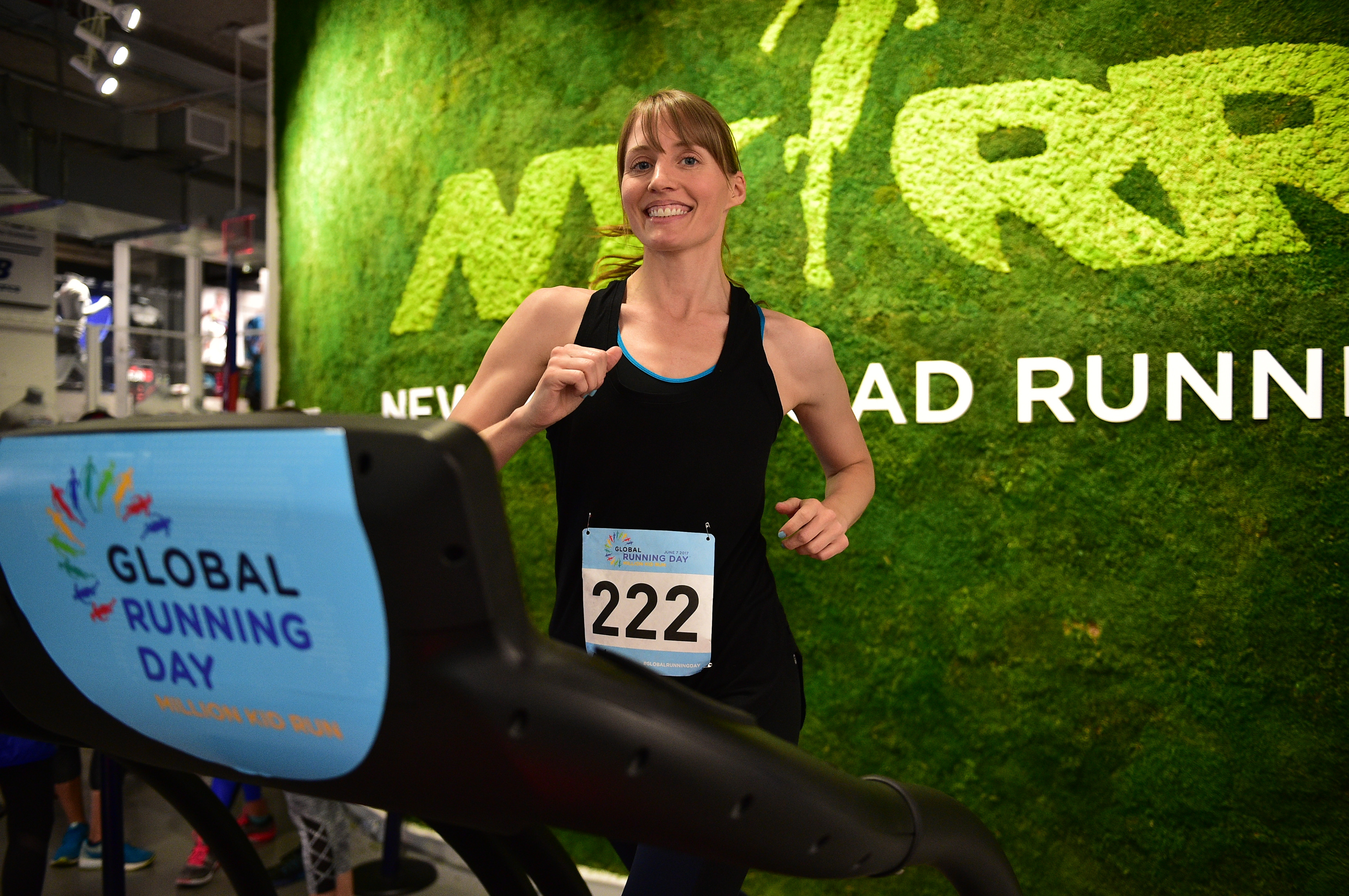 A runner in the Global Running Day Treadmill Challenge at the NYRR RUNCENTER
