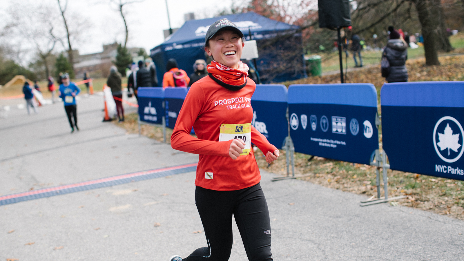A woman running past and smiling at the camera