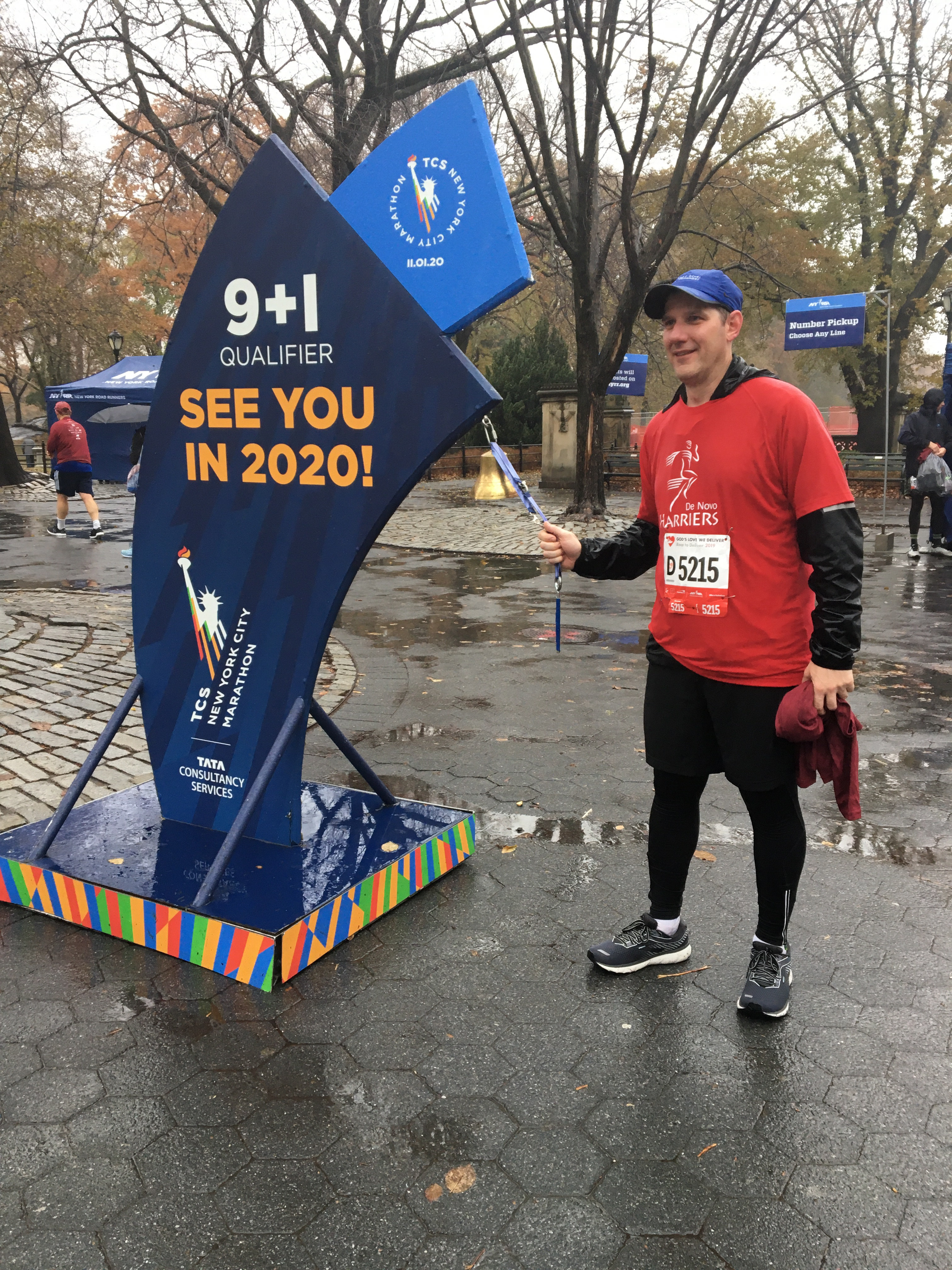 Runner ringing 9+1 bell at 2019 Race to Deliver