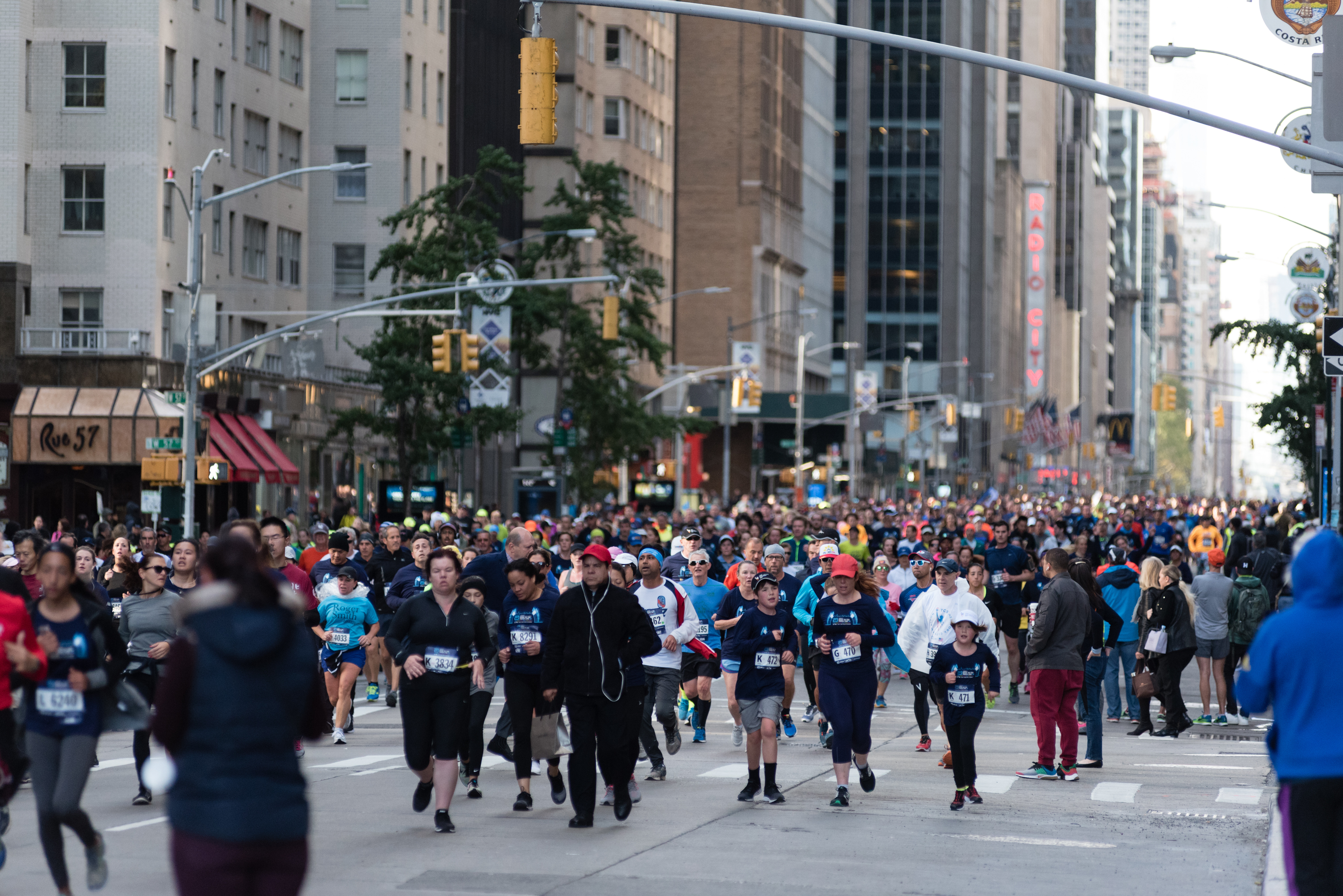 Runners on Sixth Avenue in Manhattan at the Abbott Dash to the Finish Line 5K