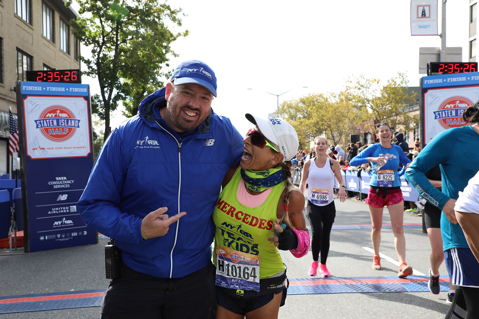 A Team for Kids finisher with Jim Heim, SVP, Event Development & Production, Race Director, TCS New York City Marathon