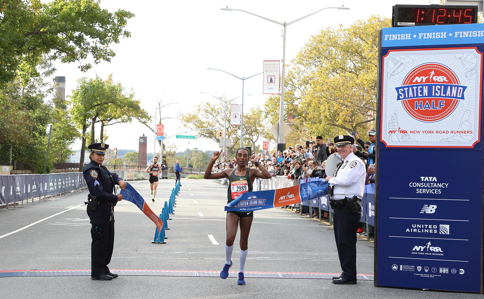 Belaynesh Fikadu of West Side Runners breaks the tape at the Staten Island Half