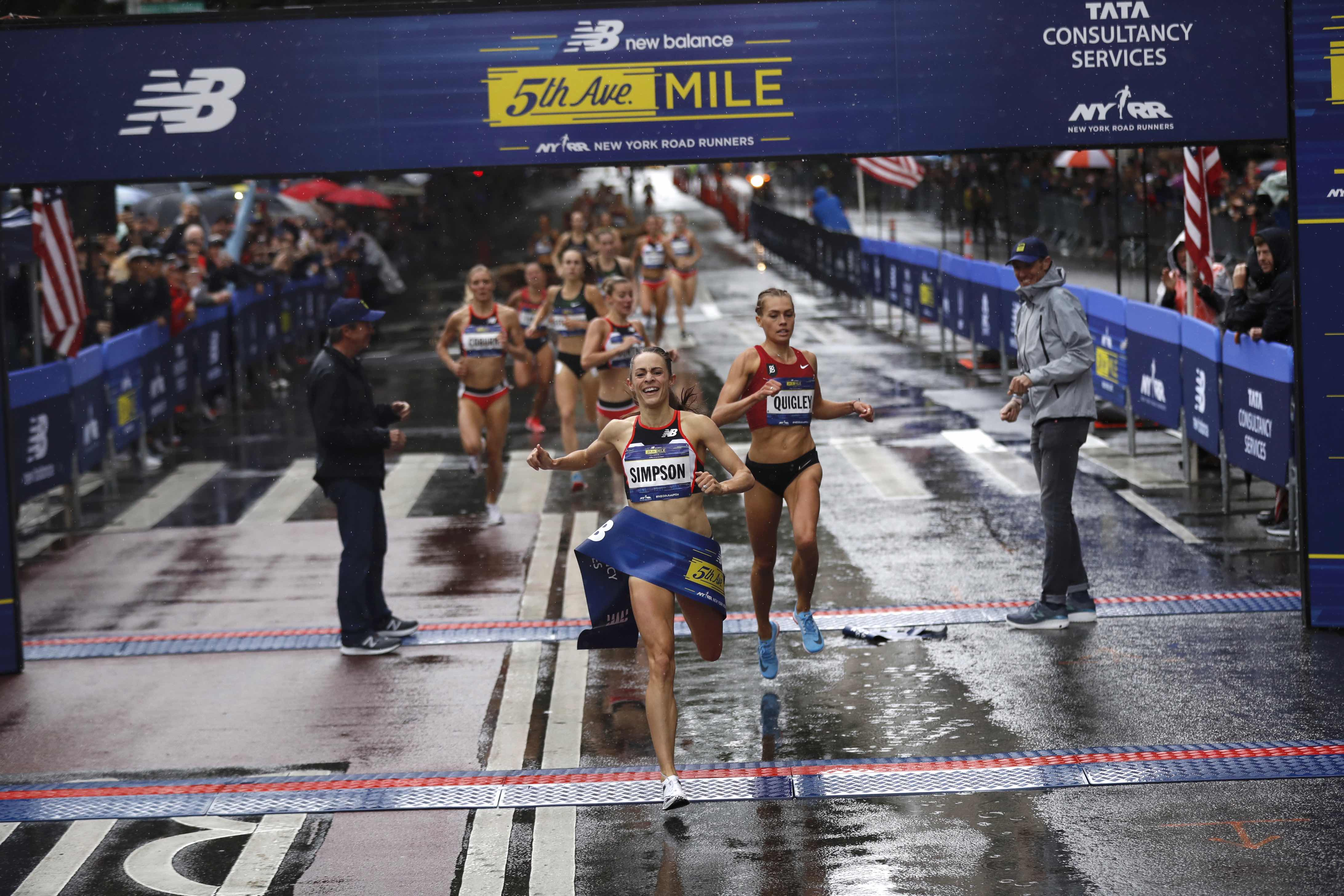 Jenny Simpson breaking the finish-line tape at the 2018 New Balance 5th Avenue Mile