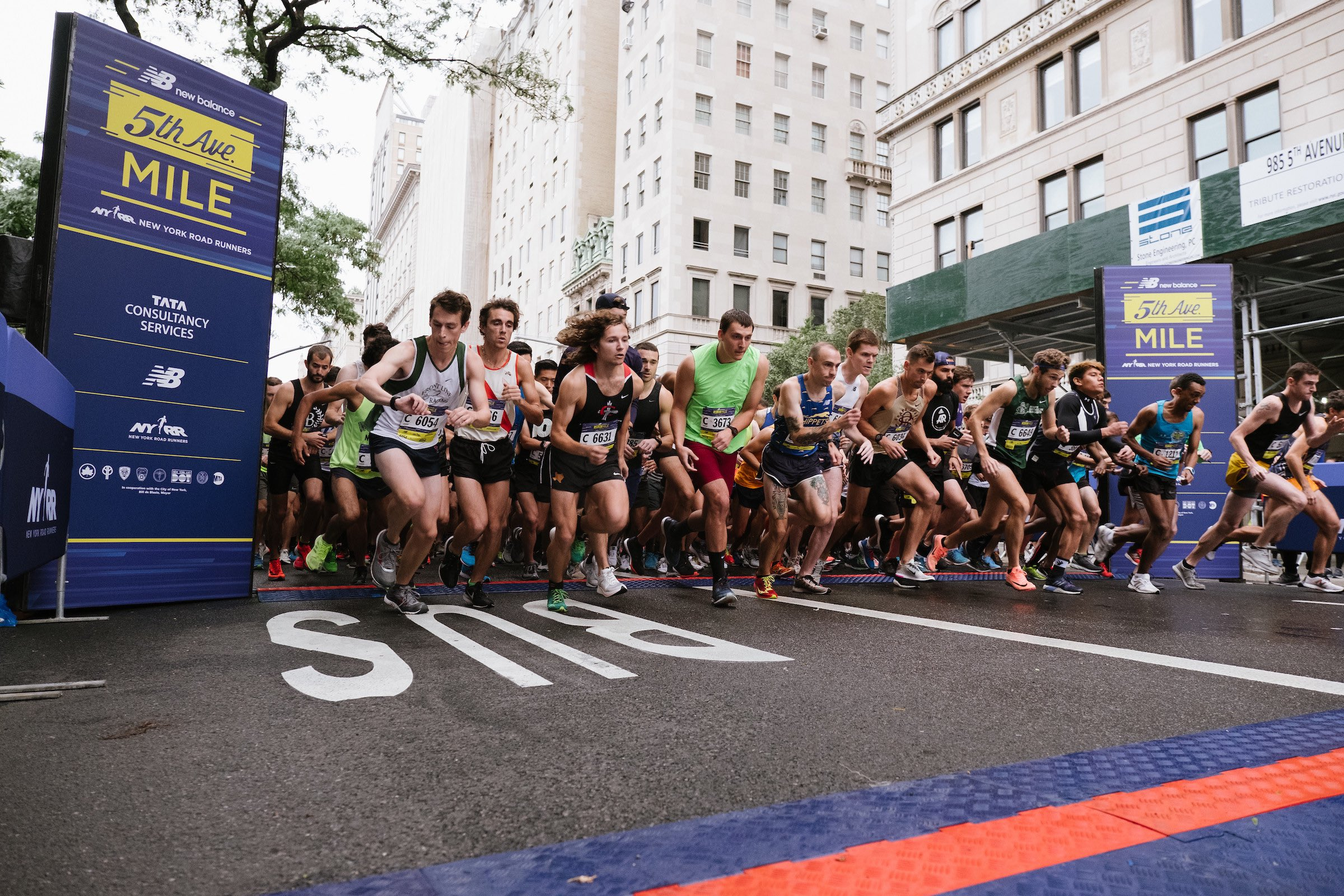 Runners at the start of a men's heat at the New Balance 5th Avenue Mile