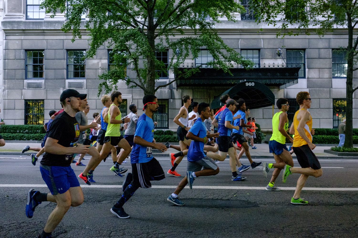Runners in the New Balance 5th Avenue Mile running past the camera