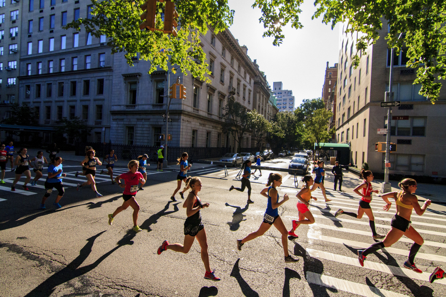 Runners in the sun in the New Balance 5th Avenue Mile