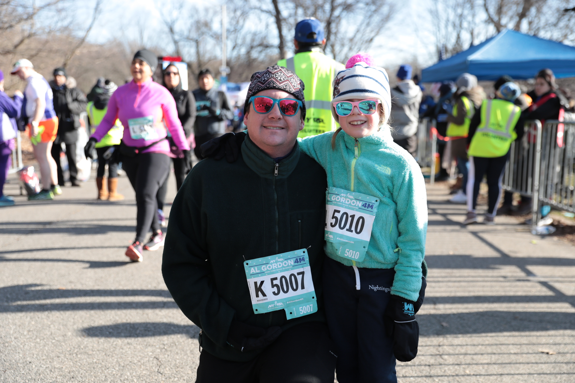 A man and his granddaughter finish the Al Gordon 4M together.