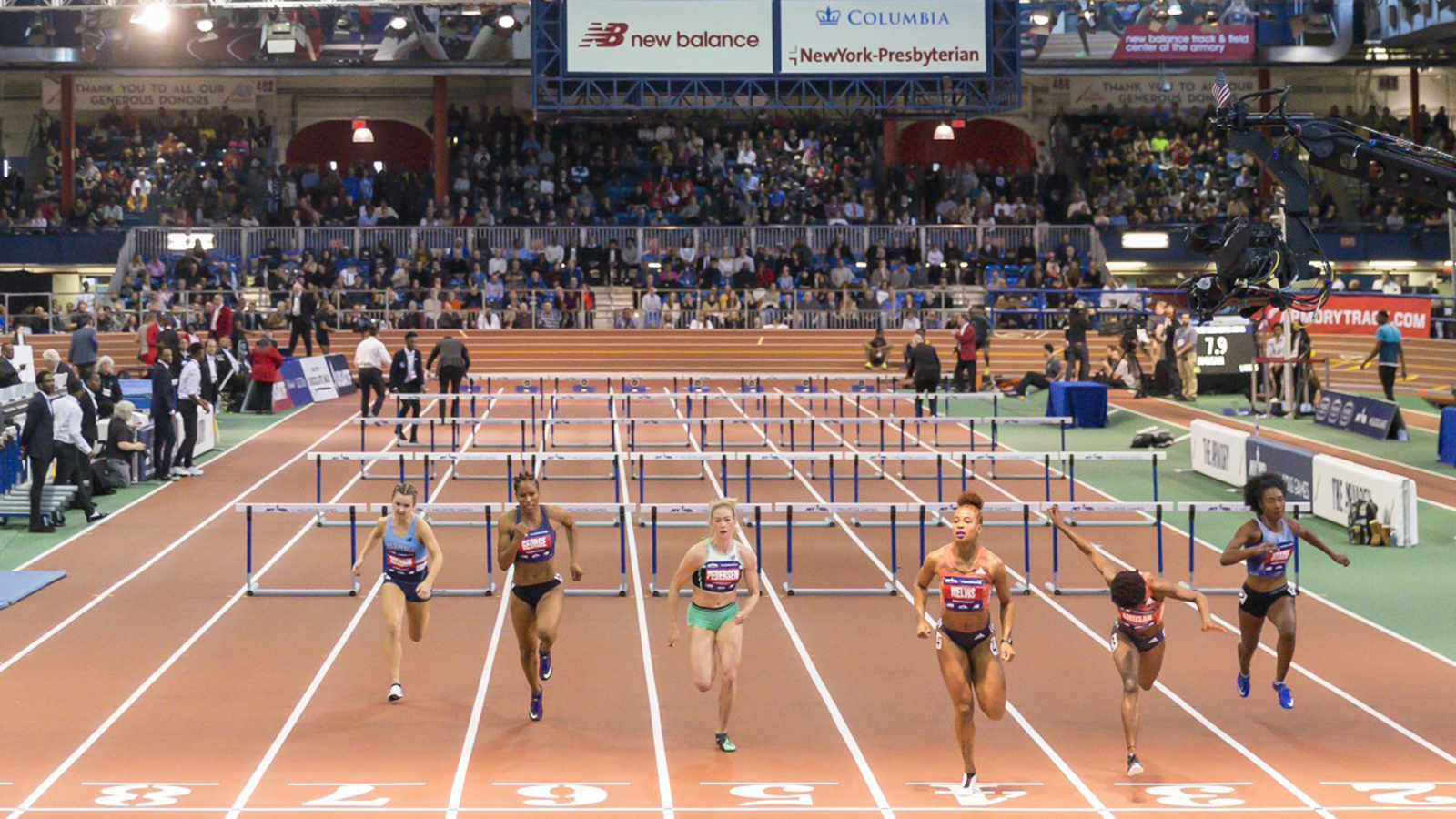 The end of a women's hurdle race in The Armory track
