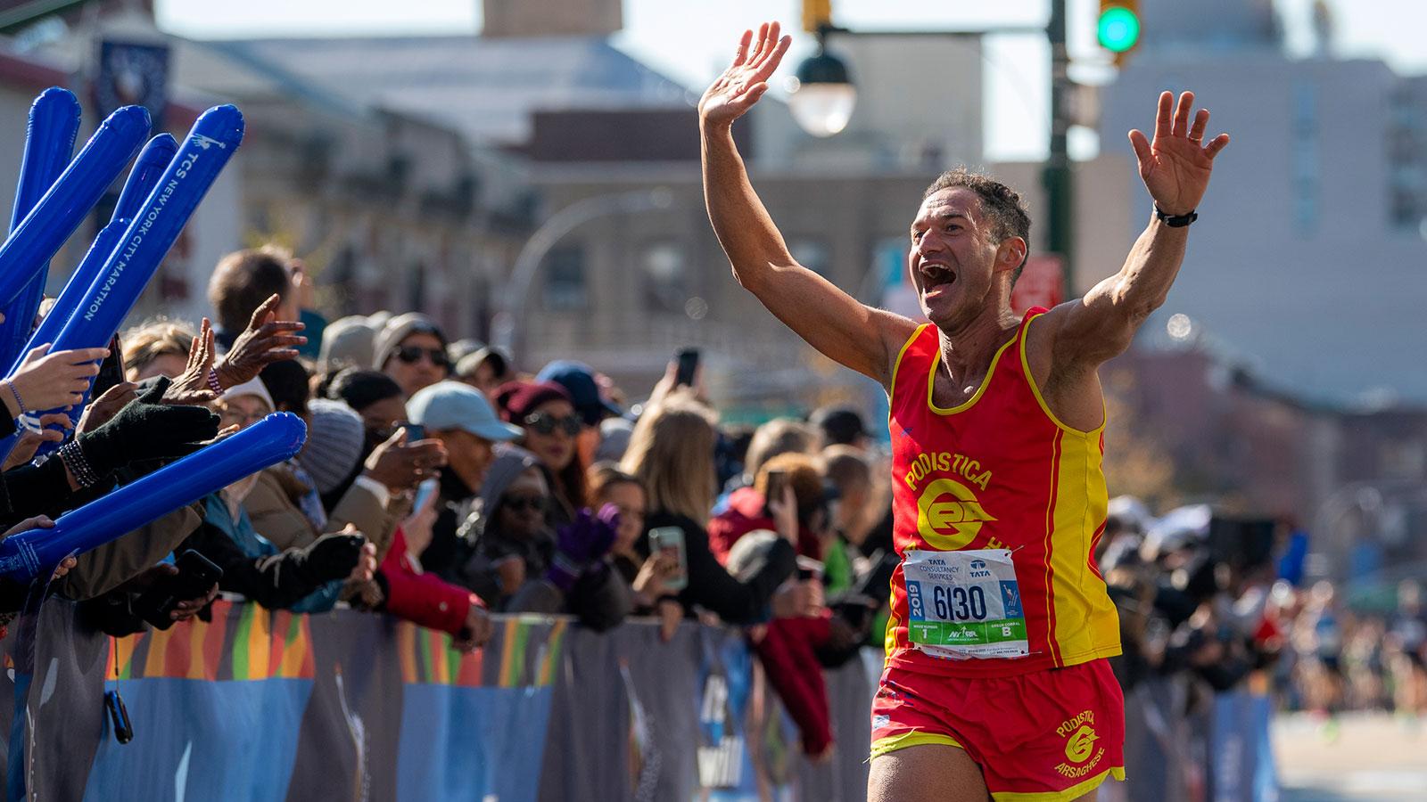 Runner and spectators at 2019 TCS New York City Marathon