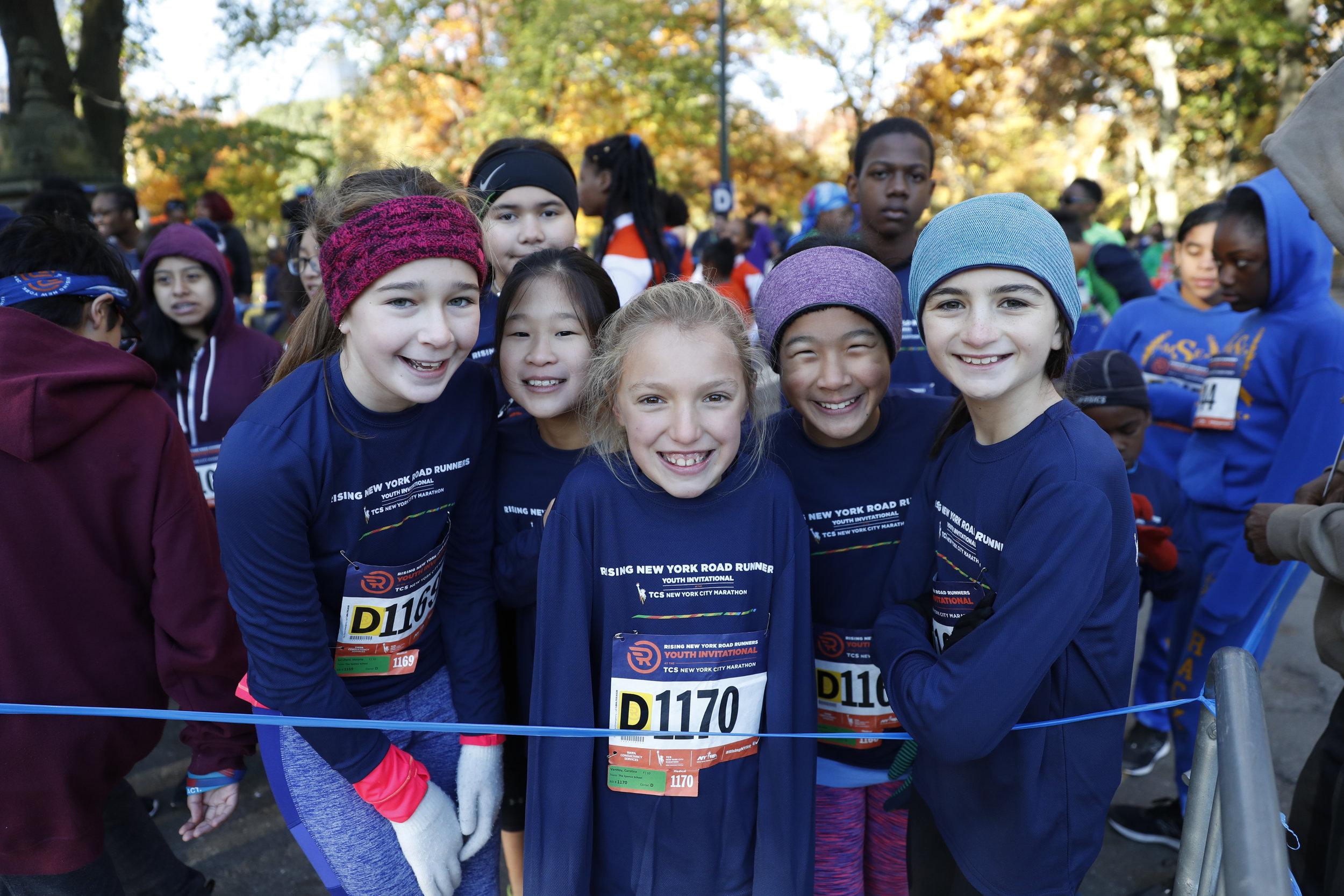Rising New York Road Runners enjoying the festivities the week of the New York City Marathon