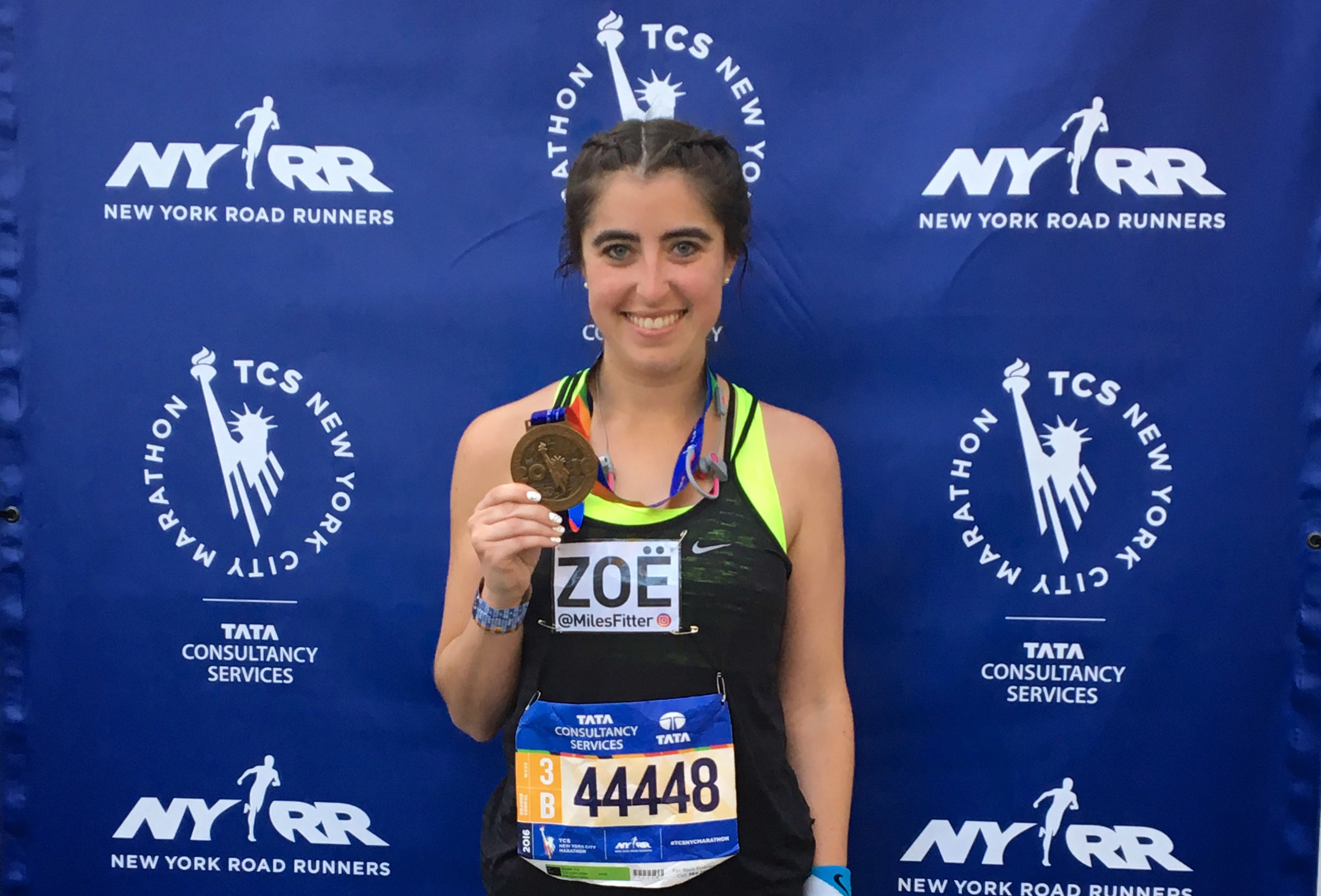 A runner with her 2016 New York City Marathon finisher's medal