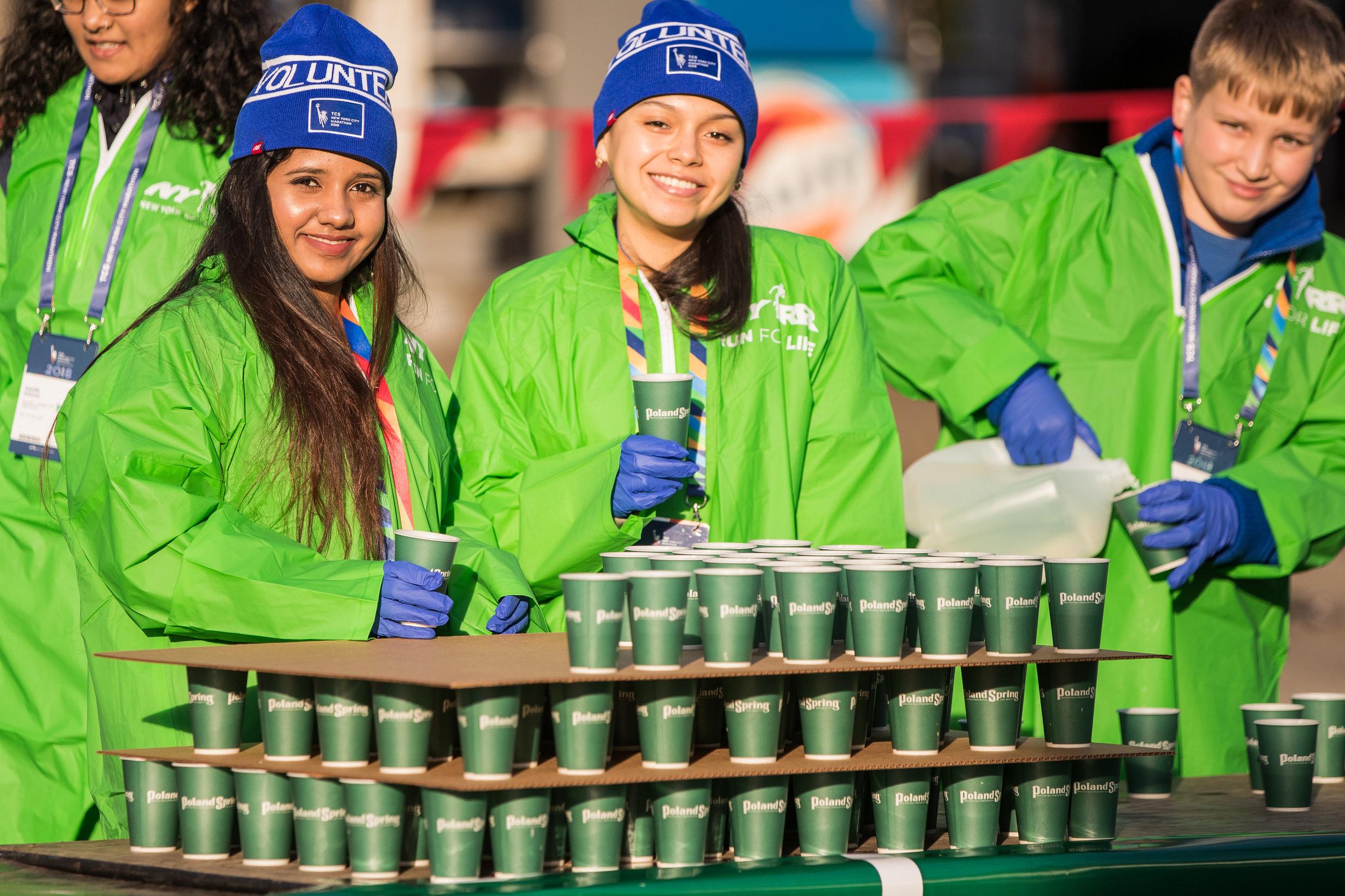 New York City Marathon volunteers at an aid station
