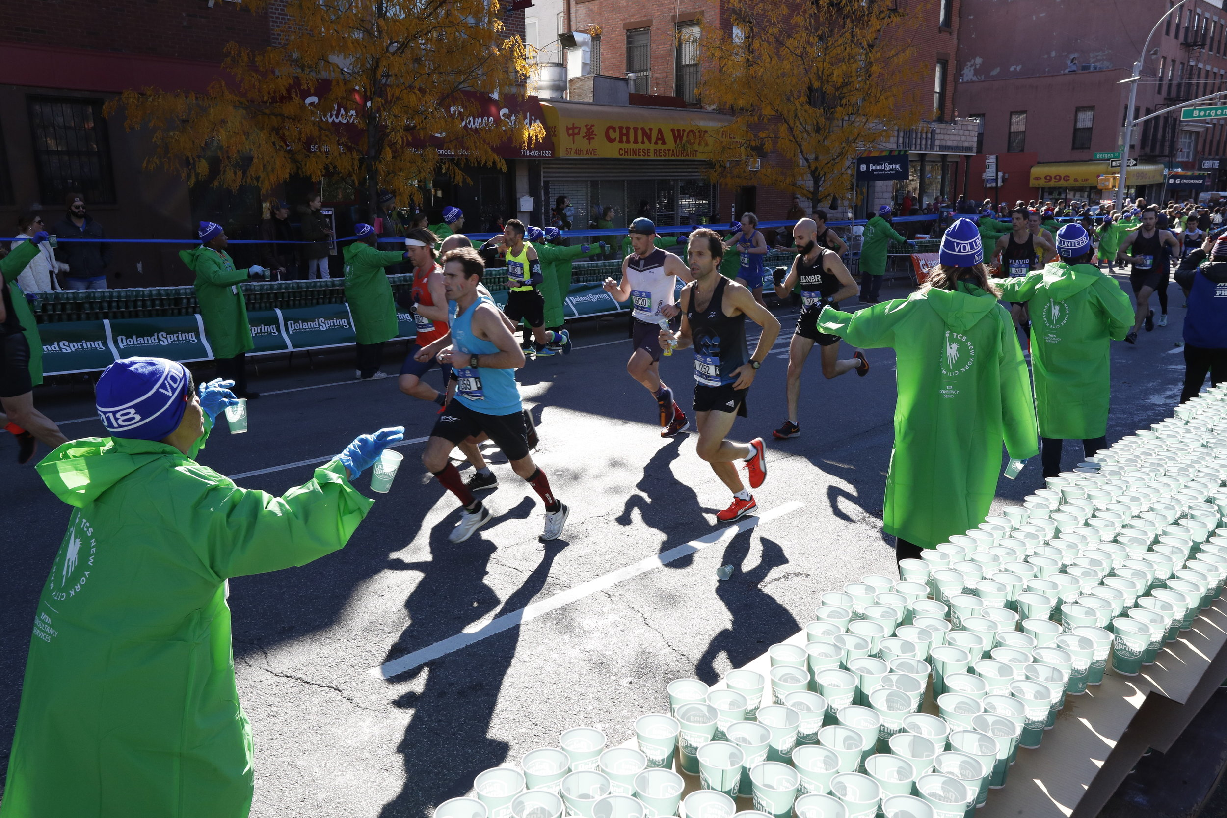 New York City Marathon volunteers at an aid station in Brooklyn