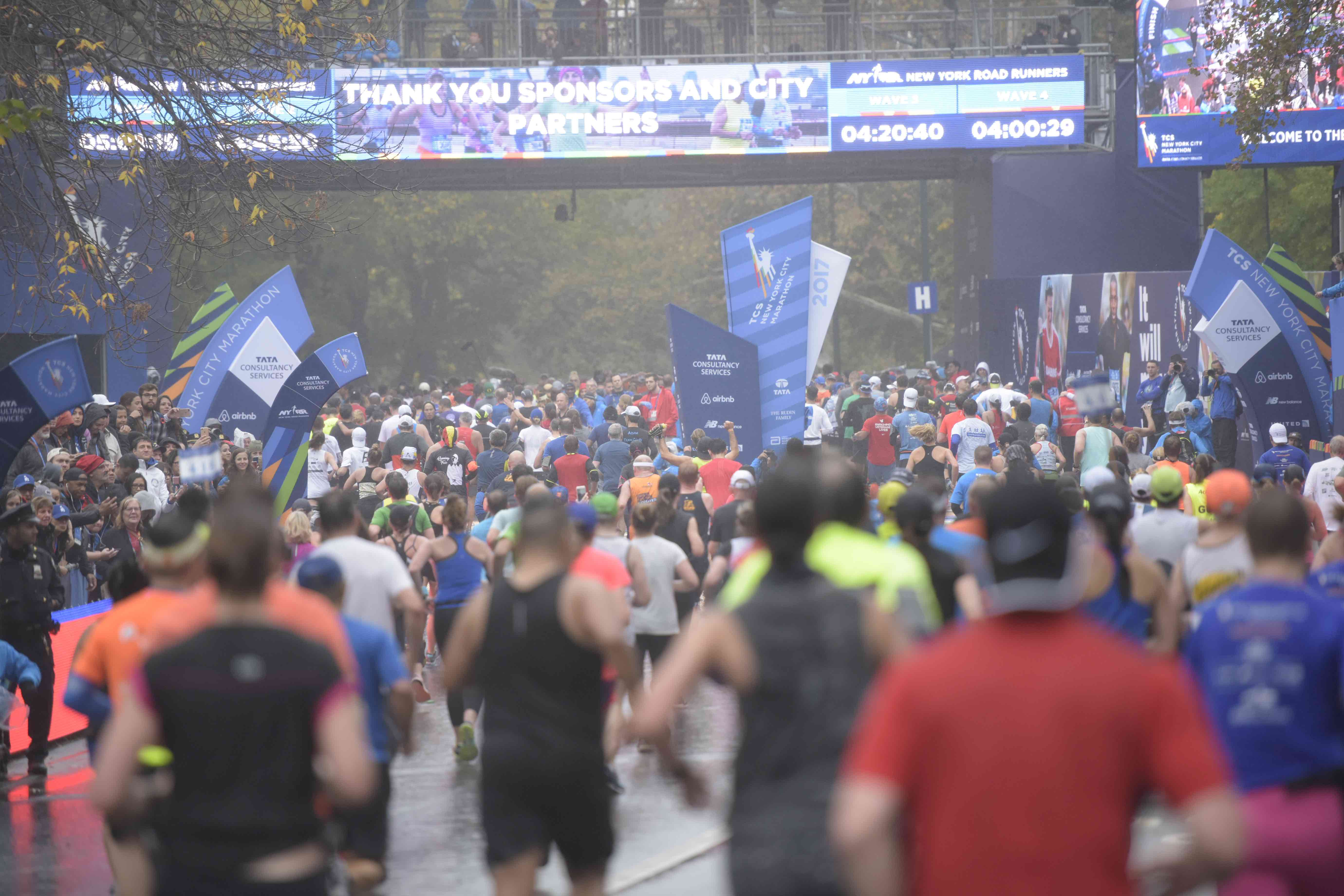 Runners approaching the finish line of the TCS New York City Marathon in Central Park