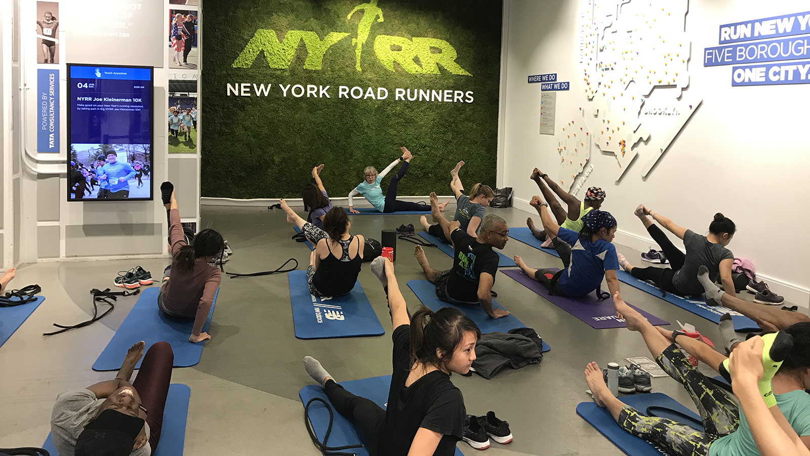 A stretching class in progress at the NYRR Run Center