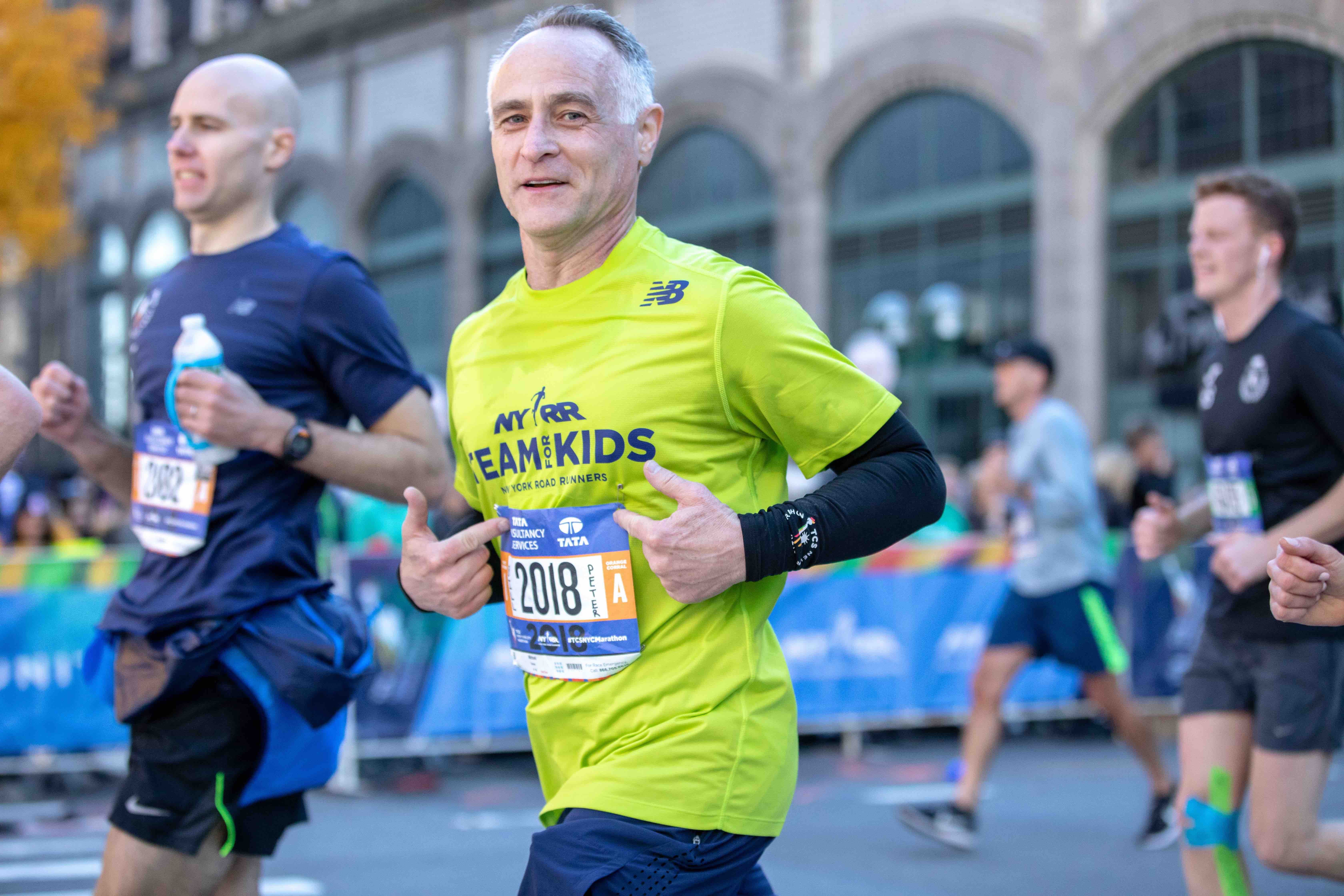 NYRR President and CEO Michael Capiraso running the TCS New York City Marathon on First Avenue in Manhattan