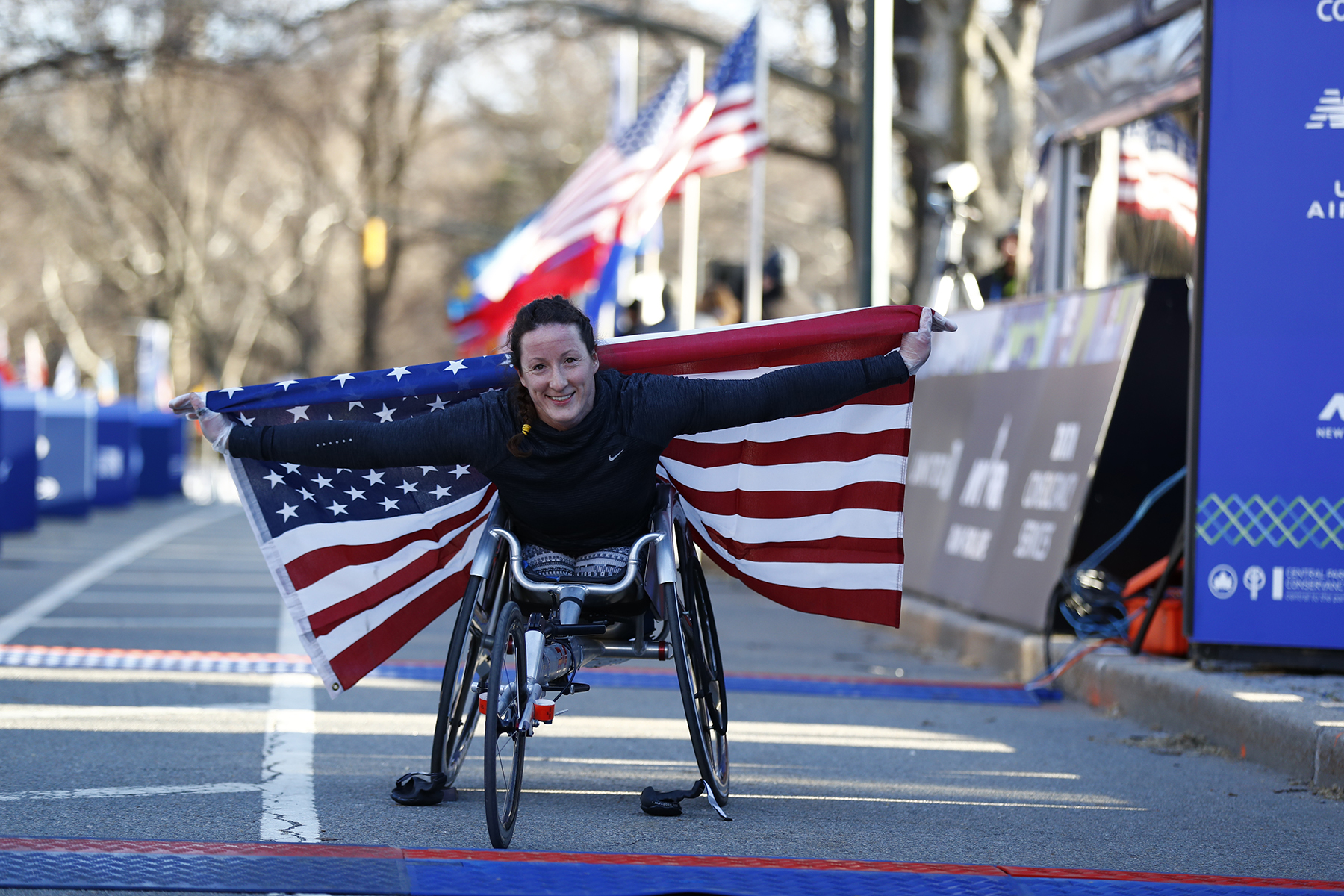 Tatyana McFadden holding the flag of USA after winning the United Airlines NYC Half