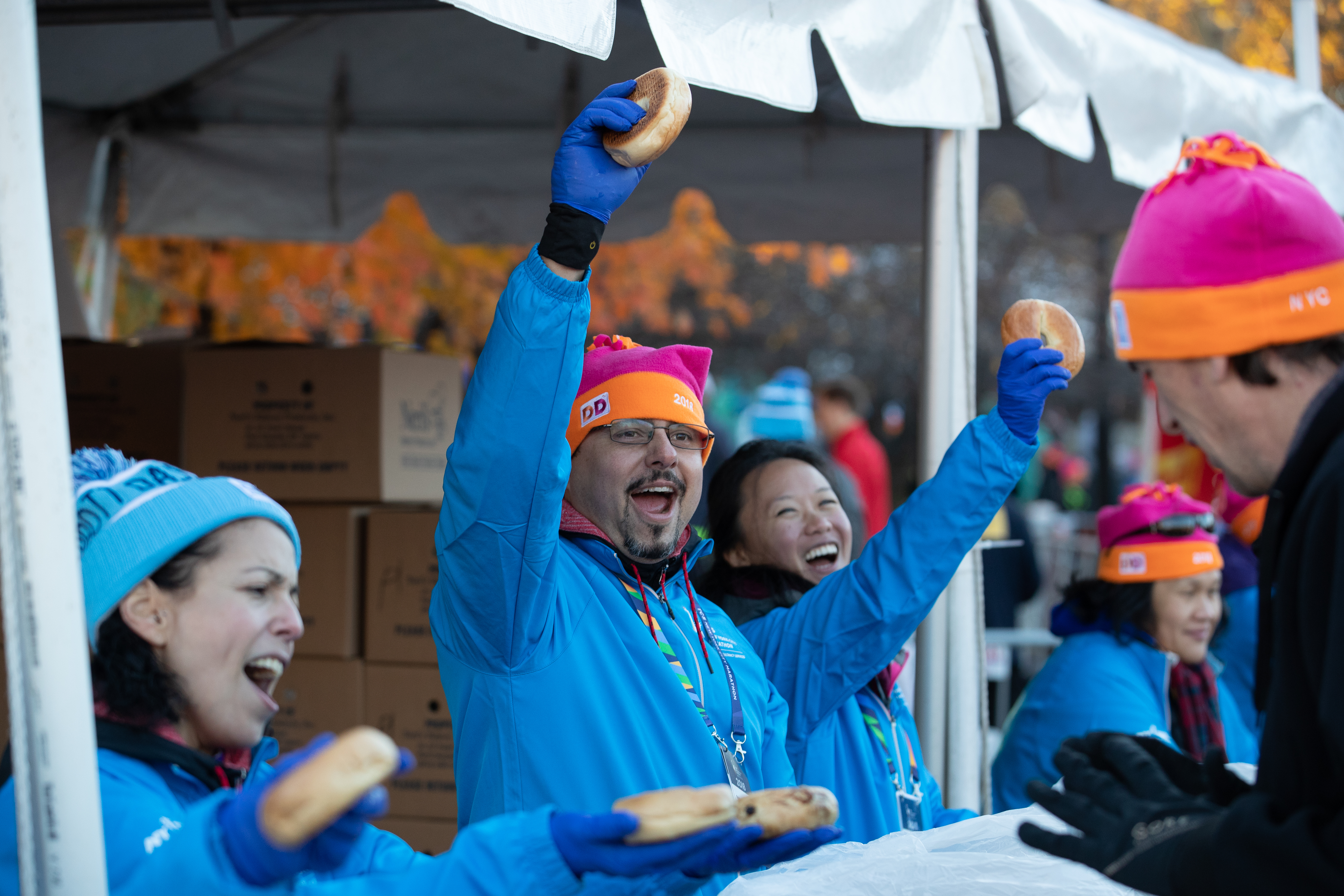 Volunteers handing out bagels at the New York City Marathon starting village