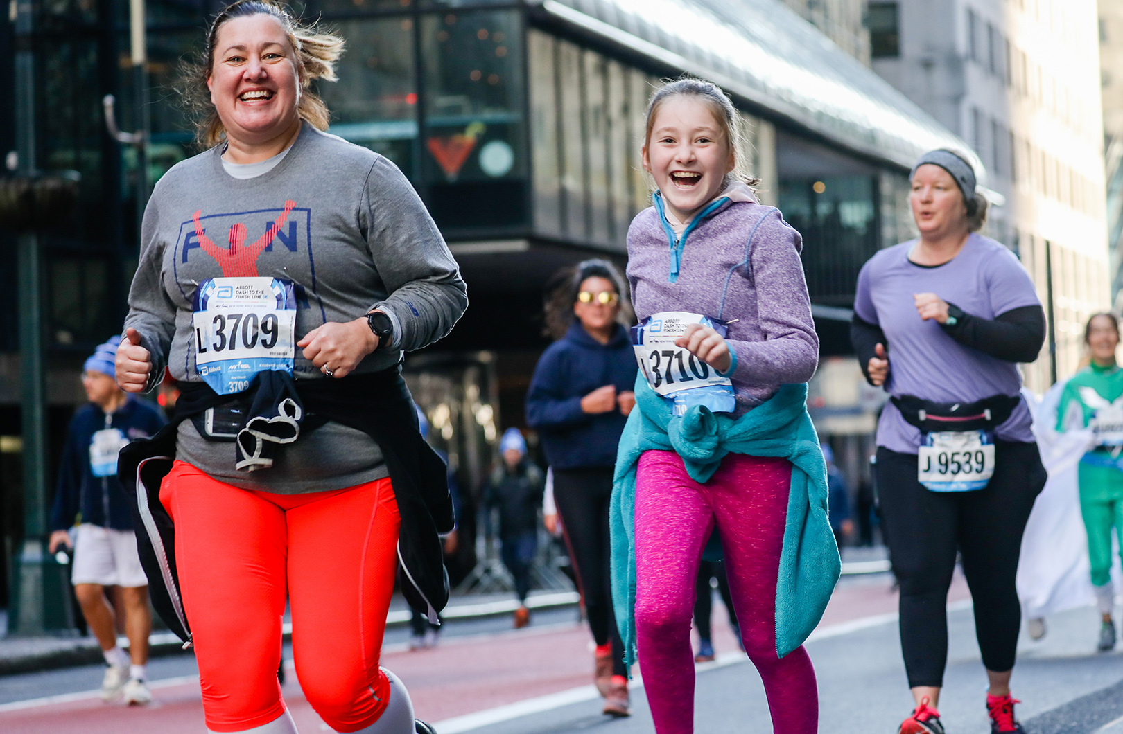 A family running the 2019 Abbott Dash to the Finish Line 5K