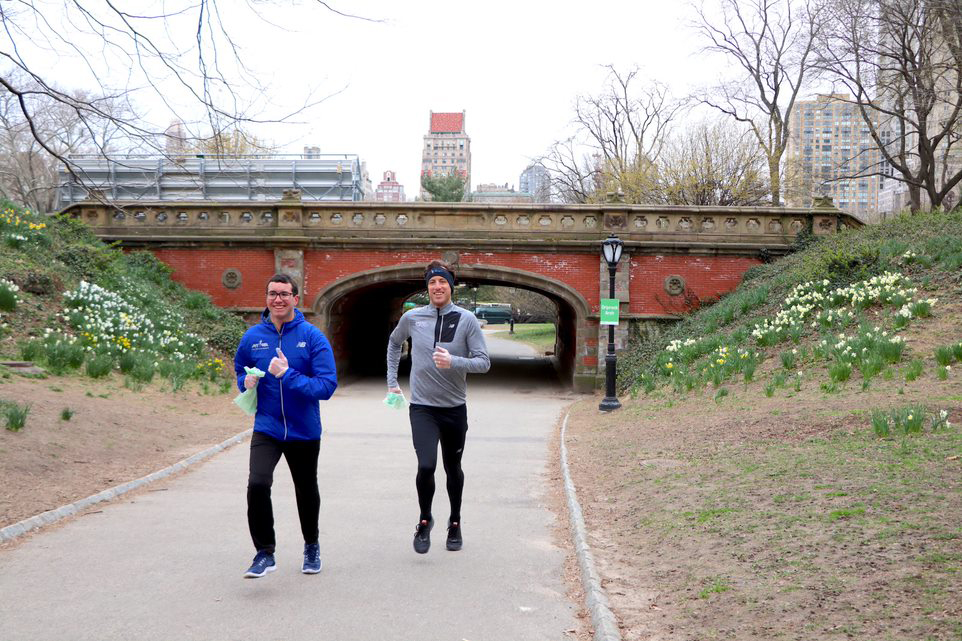 Two runners plogging in Central Park