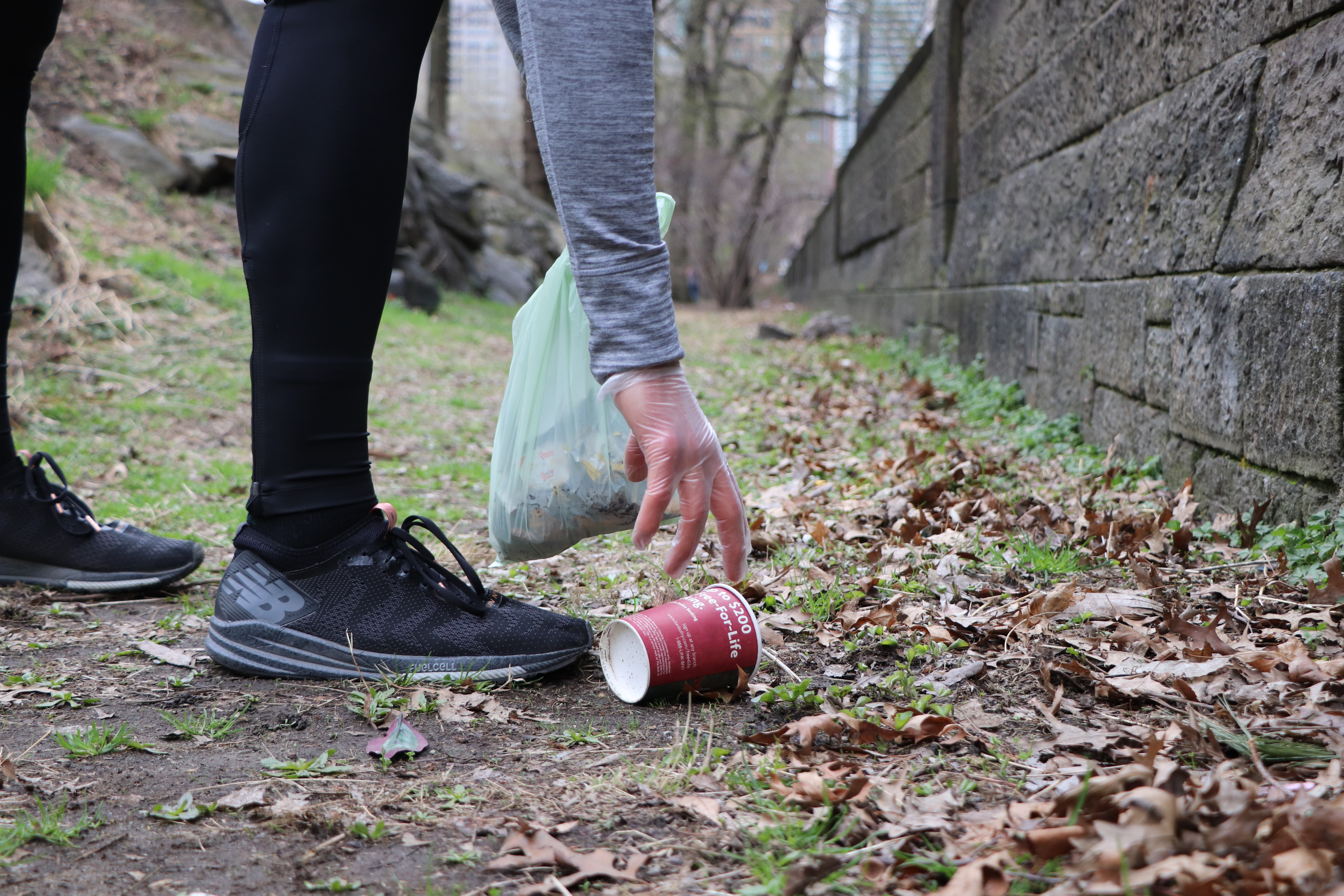 Runner picking up trash in Central Park