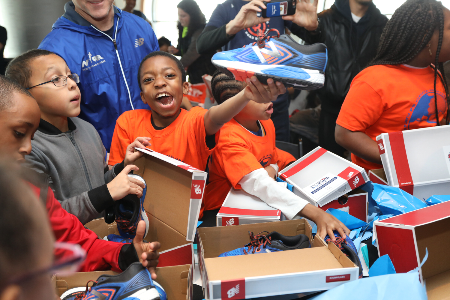 Kids receiving free shoes as part of NYRR's 1 For You 1 For Youth program
